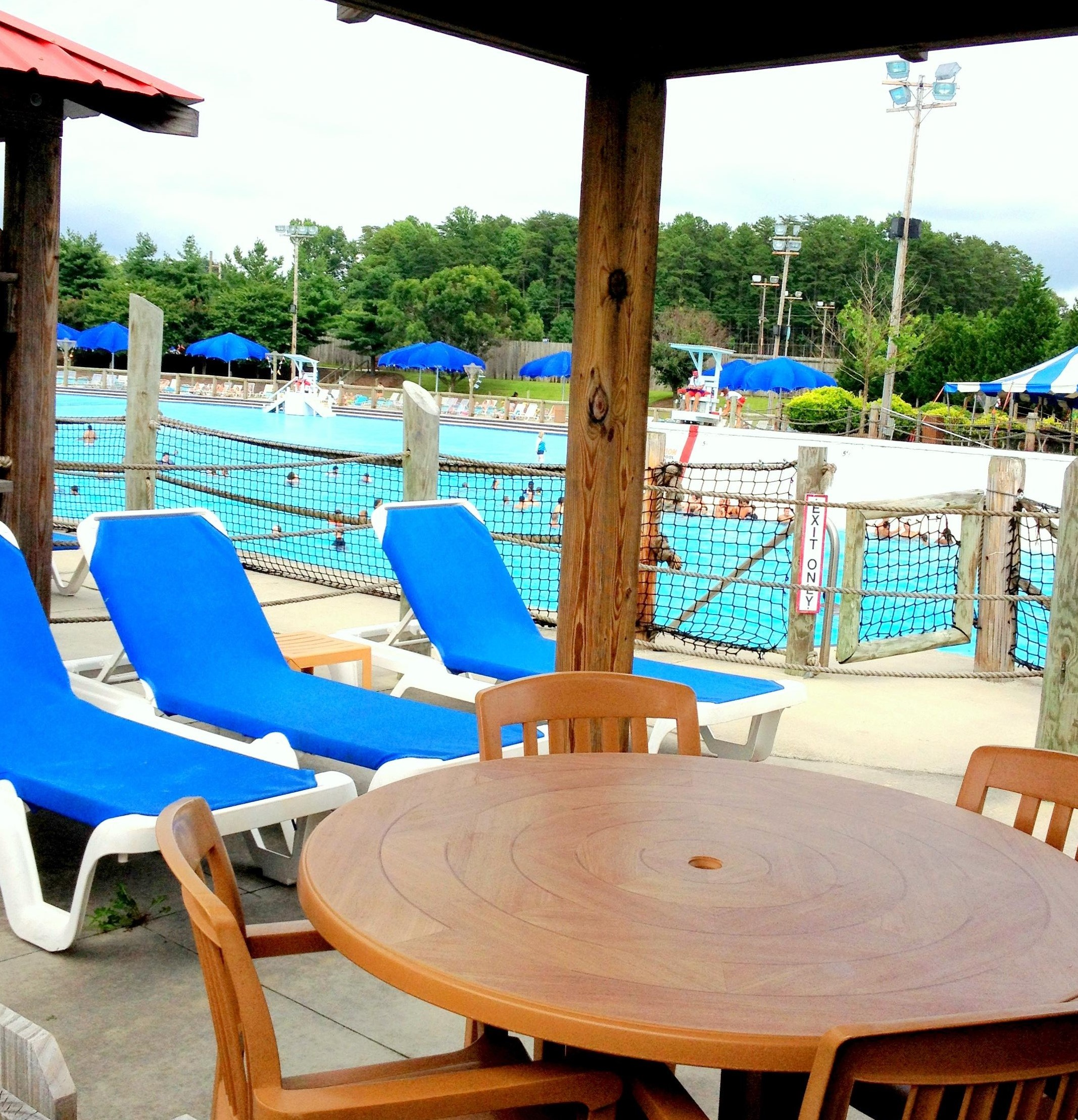 Cabana located in Happy Harbor with chairs and table
