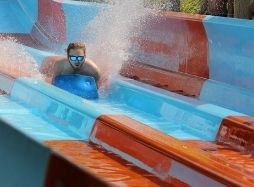 Guy wearing sunglasses racing down Riptide Racer