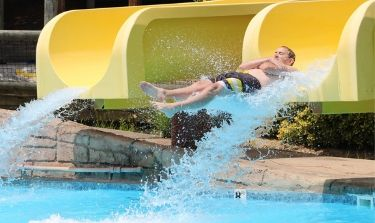 Guy flying out of the end of Double Barrel Blast slides