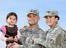 Photo of Military Family smiling holding son
