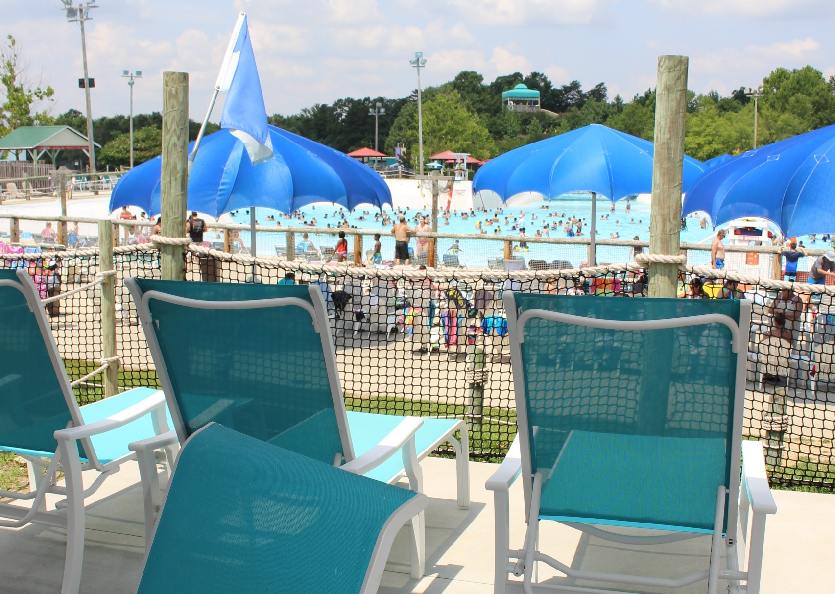 Chairs in left side cabanas looking at the huge wave pool